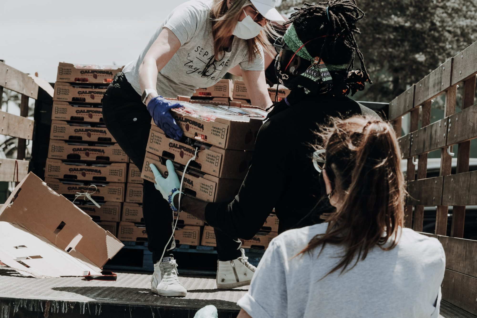 volunteers carrying boxes