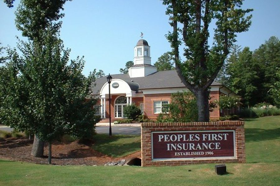 Contact Us - Peoples First Insurance Exterior of Building During Springtime