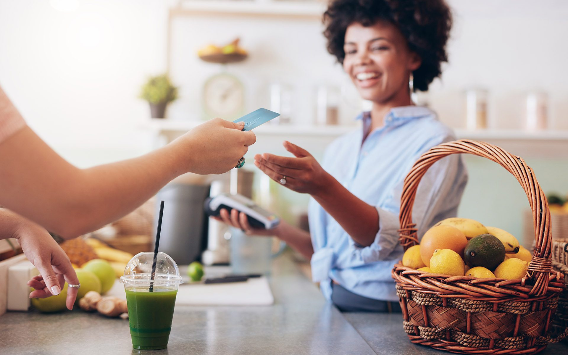 Landing Page #2 - Woman Exchanging Money at the Counter for a Smoothie