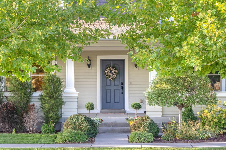 ErieSecure Home Bundles - Front Door with a Wreath on the Outside Welcoming In Visitors with a Large Robust Garden