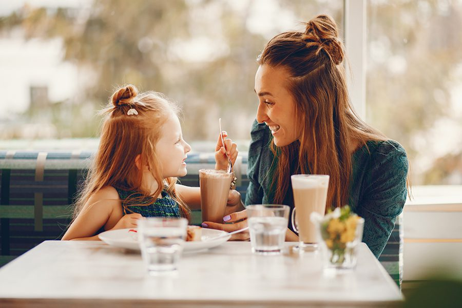 Specialized Business Insurance - Young Daughter and Mother in a Cafe in the Summer