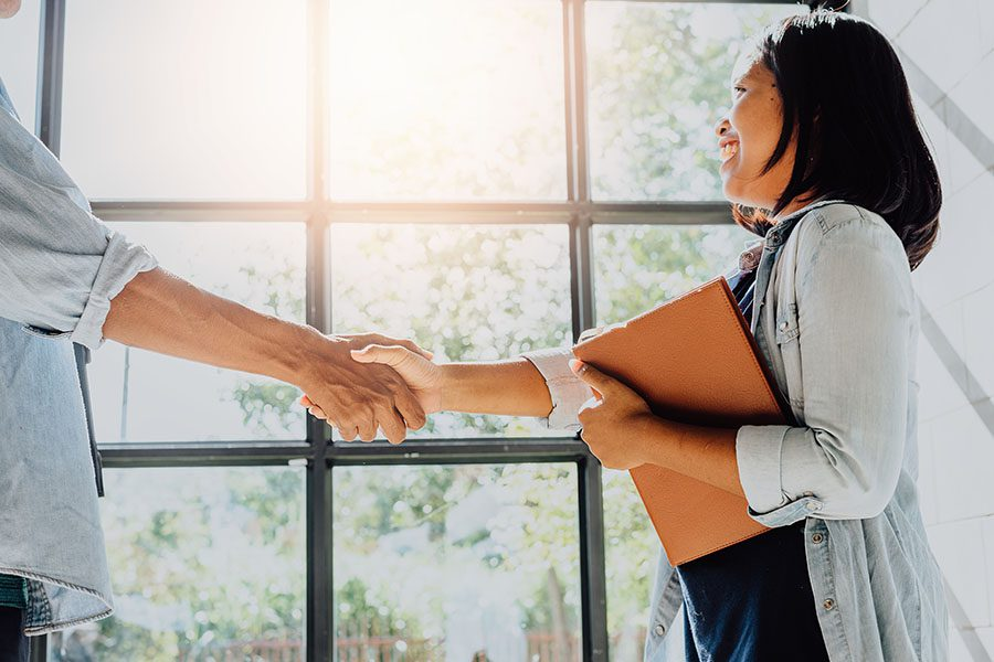 Human Resources - Woman in the Office for an Interview Shaking Hands with Manager