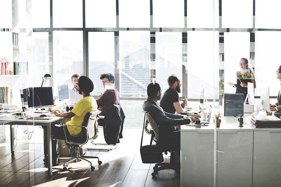 Specialized Business Insurance - View of Group of Employees Working in Modern Office