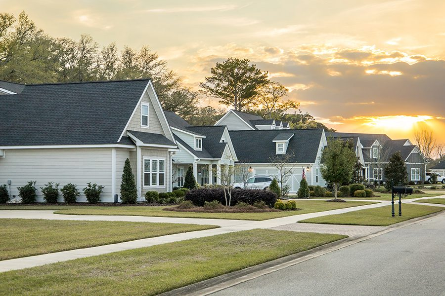 Forty Fort, PA - A Street View of a Neighborhood with Landscaped Homes and Houses with Yards and Sidewalks at Dusk