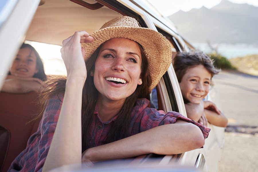 Personal Insurance - Mother And Children Relaxing In Car During Road Trip in the Summer