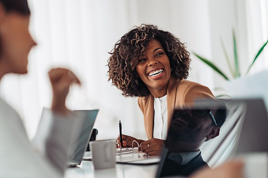 Client Center - Female Executive Laughing During Business Meeting
