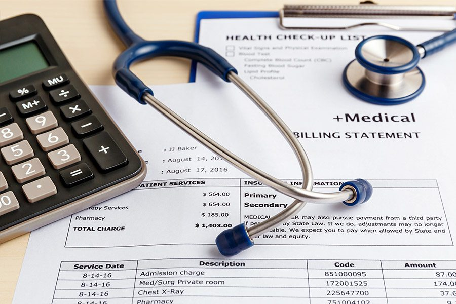 Logicomp Medical Bill Review - Stethoscope, Calculator, and Documents Spread Out on a Table