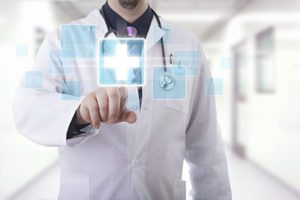 Doctor in a Hospital Hallway Wearing a Lab Coat and Stethoscope Taps Virtual Icons With Health Symbols