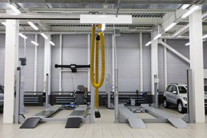 Vehicle Lifts and Other Tools Seen in a Clean Auto Shop