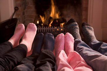 Warming toes by fire