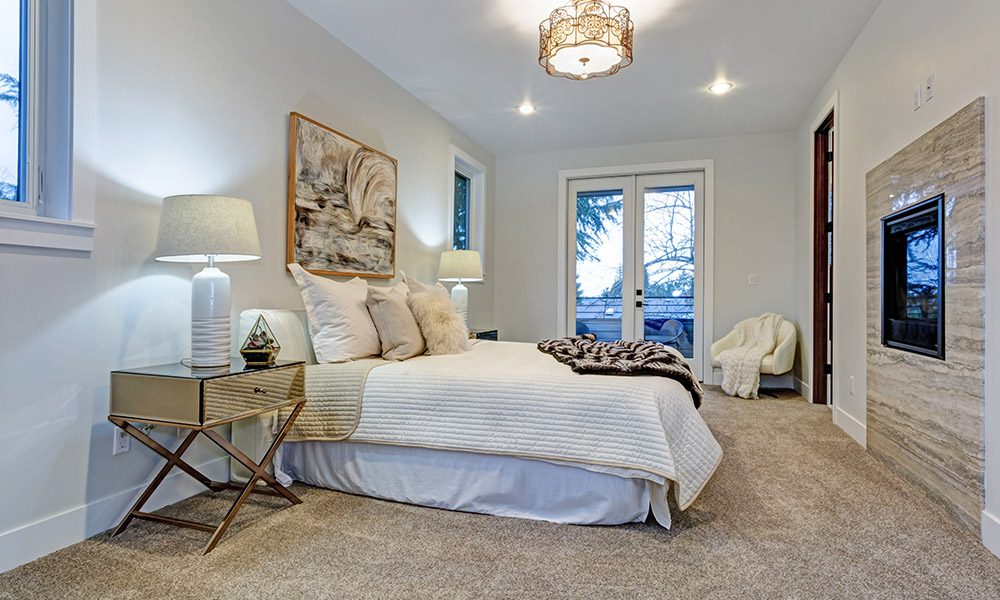 Blog - Does my homeowners insurance cover Airbnb or VRBO properties - Modern Guest Bedroom Cleaned Up With White Walls and Decor