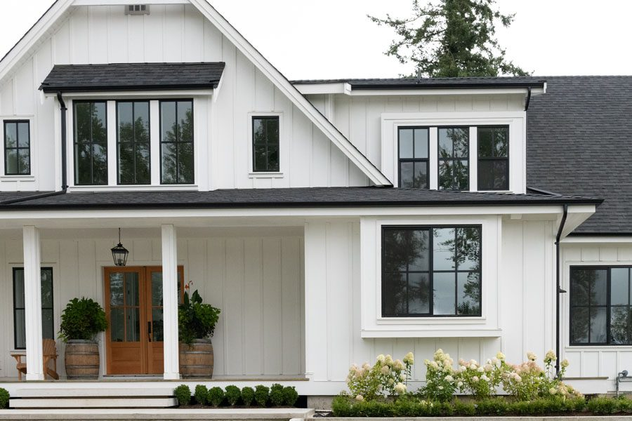 Personal Insurance - Modern Farmhouse Home with Flowers in the Front Yard