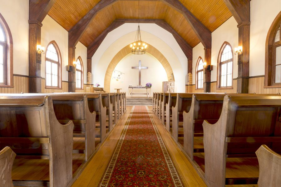 Specialized Business Insurance - View of a Church Aisle During the Summer