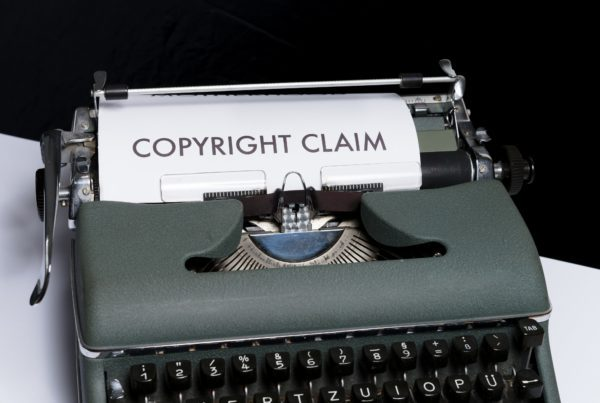 Copyright claim printed on a paper in a typewriter speaking about liability insurance.