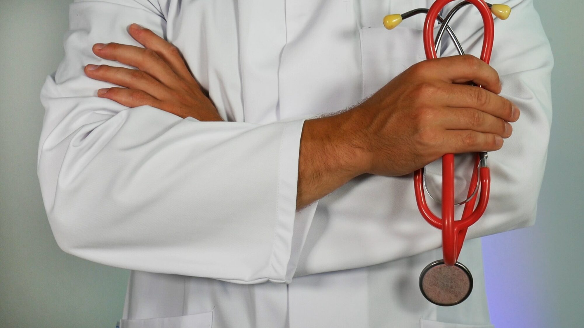 Doctor holding a stethoscope with crossed arms