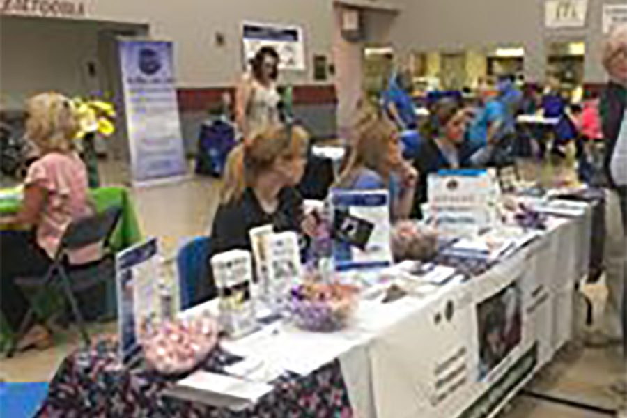 Community Involvement - Booth Setup During Senior Expo Hosted By Williams Agency