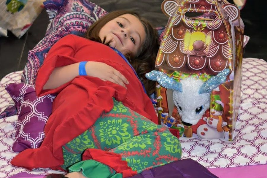 Community Involvement - Little Girl Laying in Bed with Stuffed Animal During Sleep Dreams Event