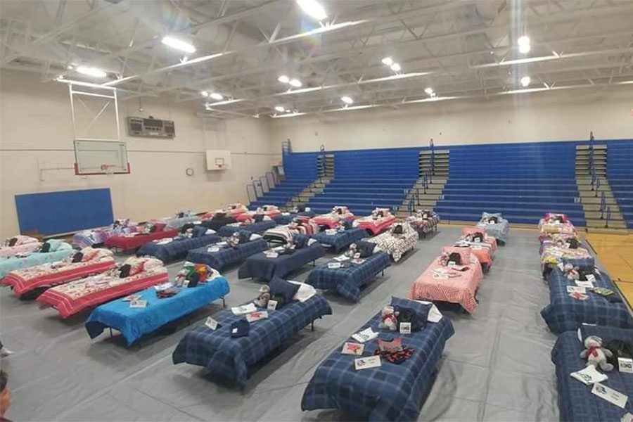Community Involvement - Rows of Beds at School Gym During Sleep Dreams Event