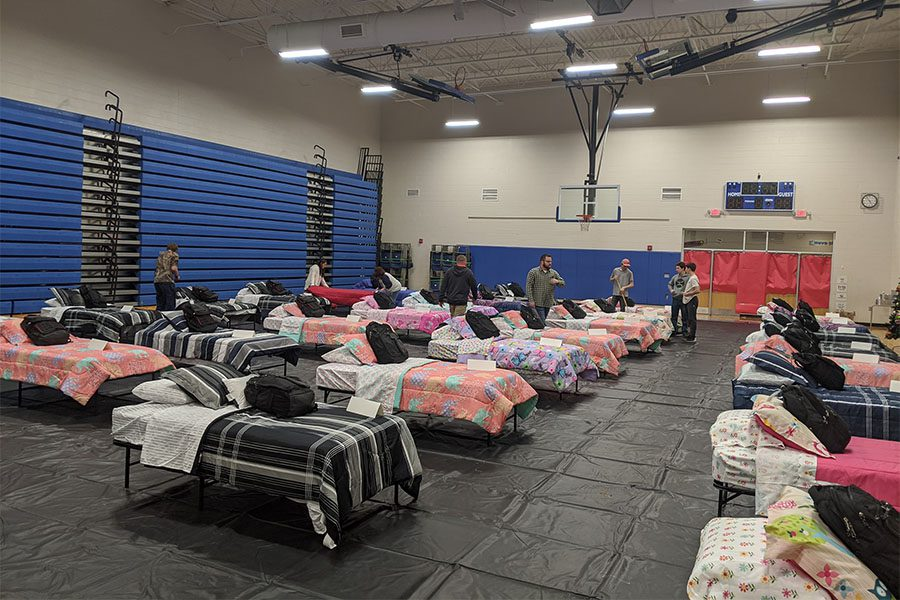 Community Involvement - Williams Agency Staff Setting Up Beds in Gym for Sleep Dreams Event