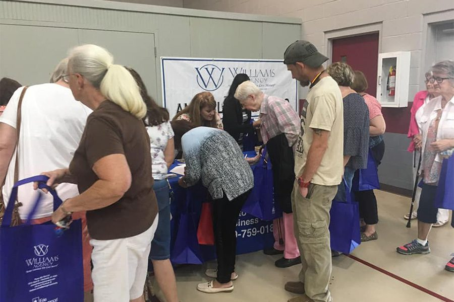 Community Involvement - Williams Agency Team Volunteering at Senior Expo