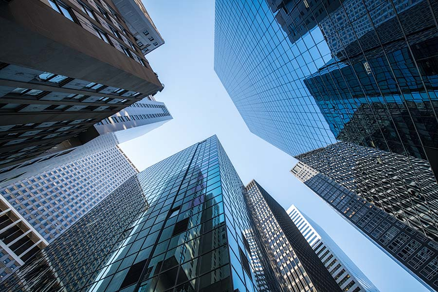Business Insurance- View of Modern Skyscrapers Against Blue Sky