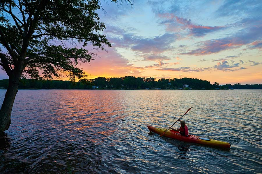 Life And Health - Woman Kayaking Out On Lake At Sunset