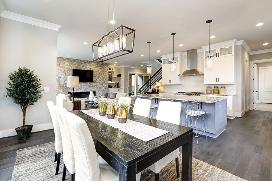 Personal Insurance - Modern Kitchen with Dining Room Table and Hanging Lights
