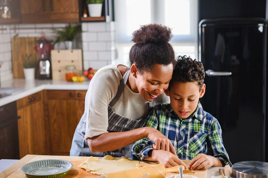 Personal Insurance - Mother and Son Making a Pie After School Together