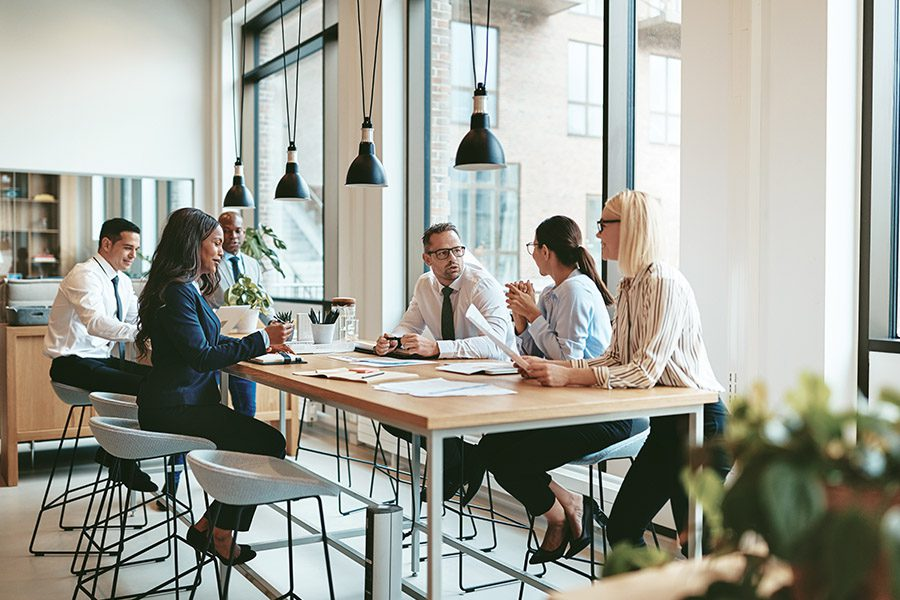Cannabis Directors and Officers Liability Coverage - Business Team Working Together In A Large Open Office Space