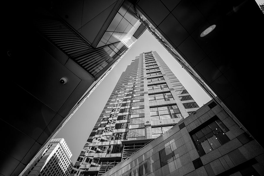 Business Insurance - Upwward View of Modern Architecture and Skyscrapers in Black and White