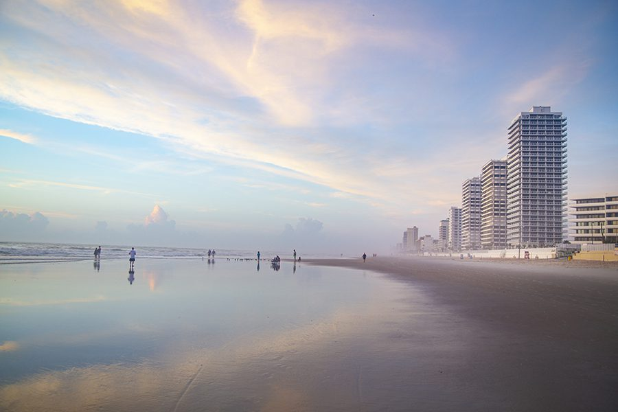 Location - Foggy Morning at the Beach with Buildings Along the Coast