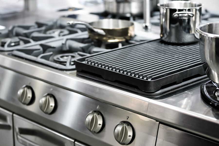 Specialized Business Insurance - Closeup View of Kitchen Stove in Restaurant