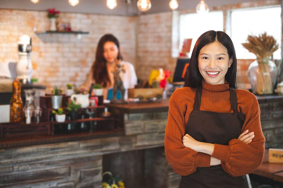 Business Insurance - Portrait Of Happy Young Bakery Owner Standing In Store