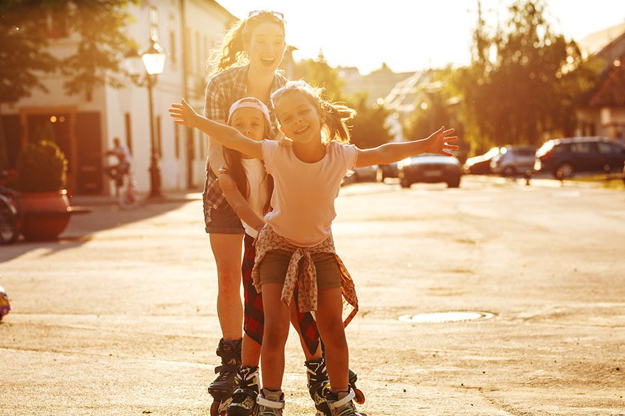 Contact - Excited Mom And Children Rollerblading On Empty Street