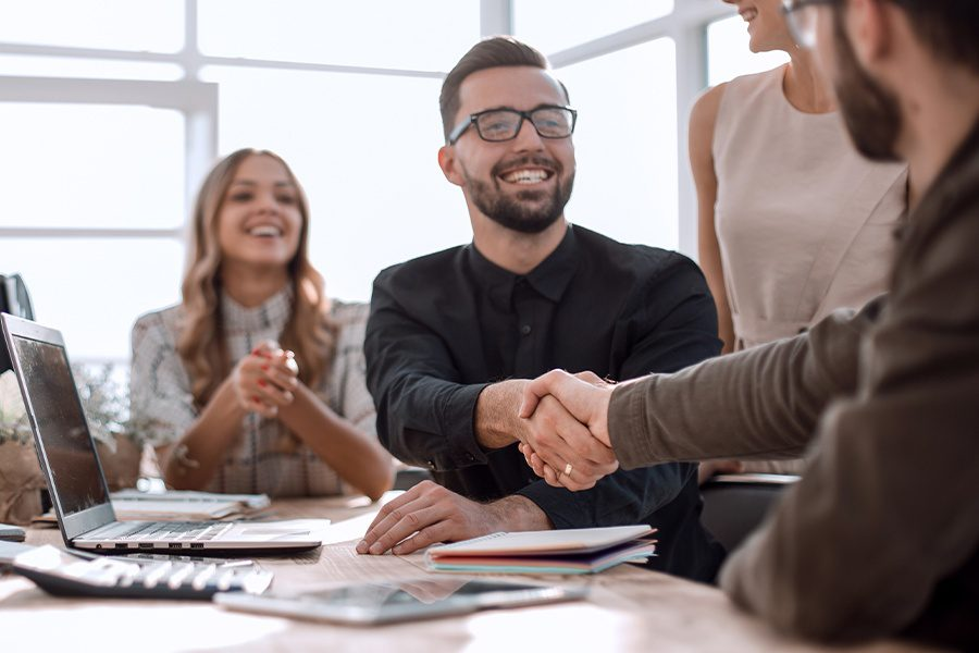 About Our Agency - Closeup View of a Handshake Between Business Partners at the Office of Rodgers & Co Insurance Agency, Inc