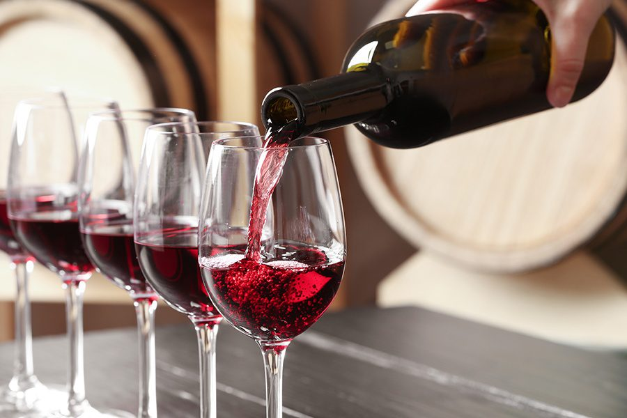 Specialized Business Insurance - Closeup of Woman Pouring Red Wine into a Glass at a Local Winery in Pennsylvania