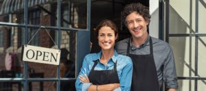 blog-business-insurance-happy-couple-standing-outside-of-business.jpeg