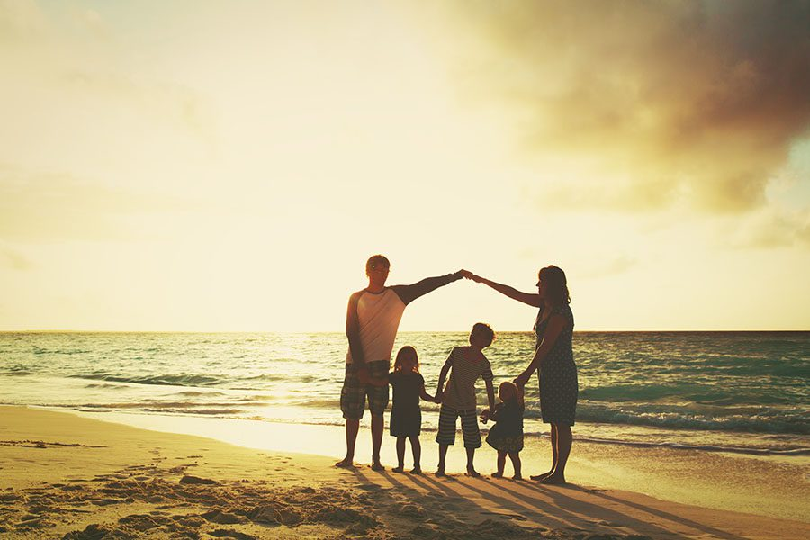 Personal Insurance - Family with Kids Having Fun at the Beach at Sunset