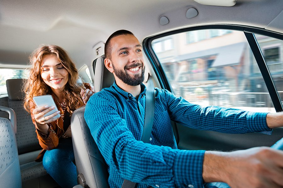 Transportation Insurance - Man Driving Woman to Her Desination Using a Transportation Service
