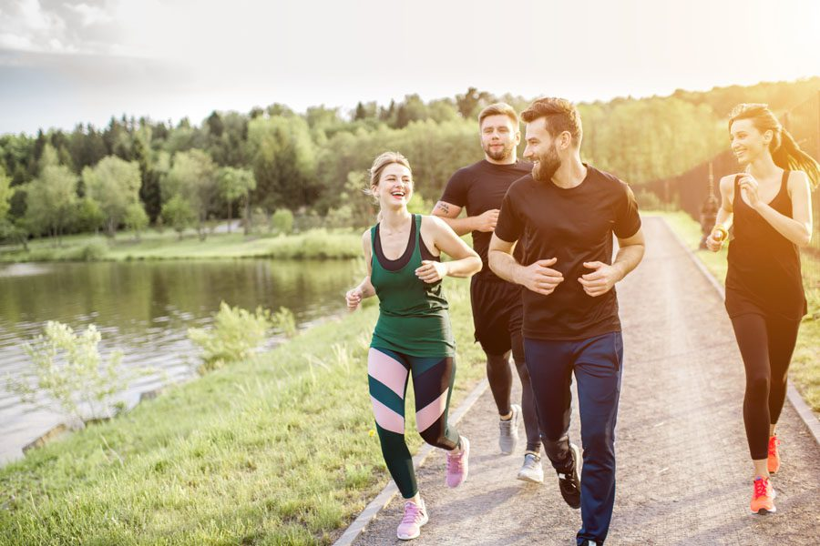 Employee Benefits - Co Workers Going on a Jog After Work