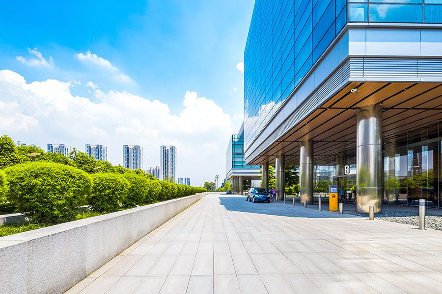 Business Insurance - Bright Imagery of Empty Modern Building Exterior on a Sunny Day with Blue Skies
