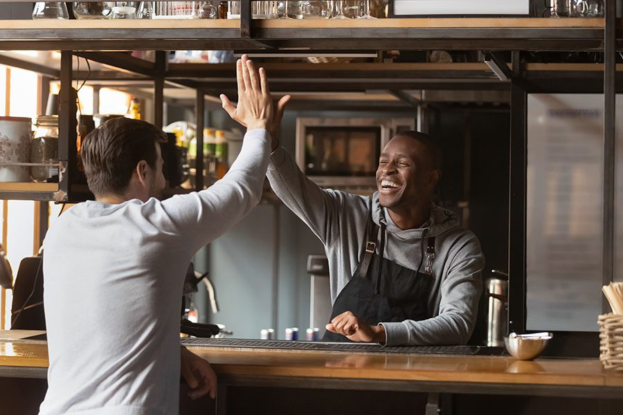 Insurance Quote - Happy Bartender Giving His Friend High Five