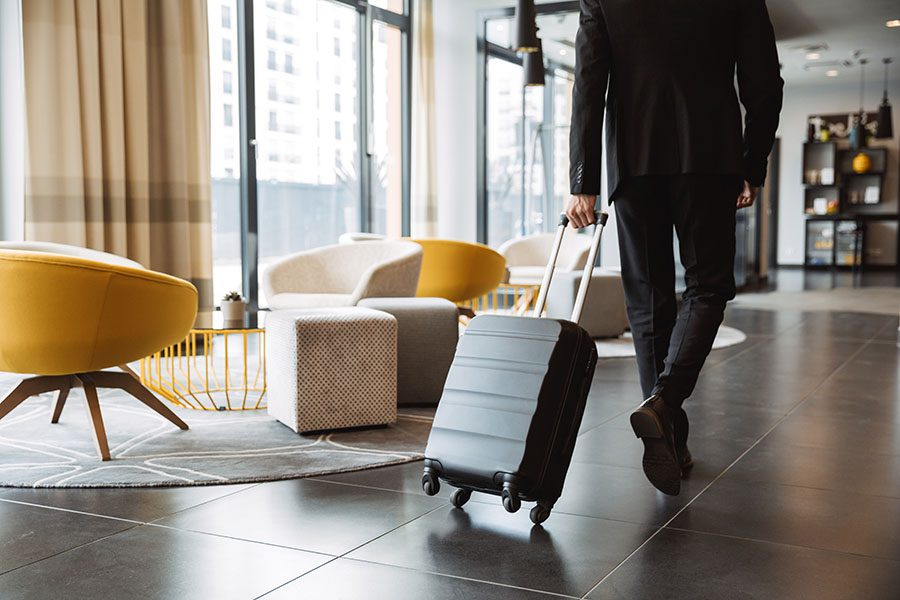 Specialized Business Insurance - View of Man Walking in Hotel Lobby with Luggage