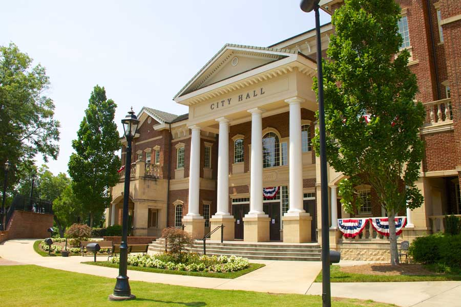 Business Industry Specialties - City Hall During July with Flags on the Outside