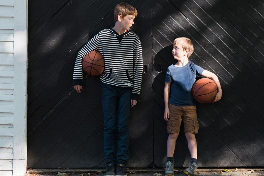 Home Insurance - Two Boys Holding Basketballs Looking at Each Other