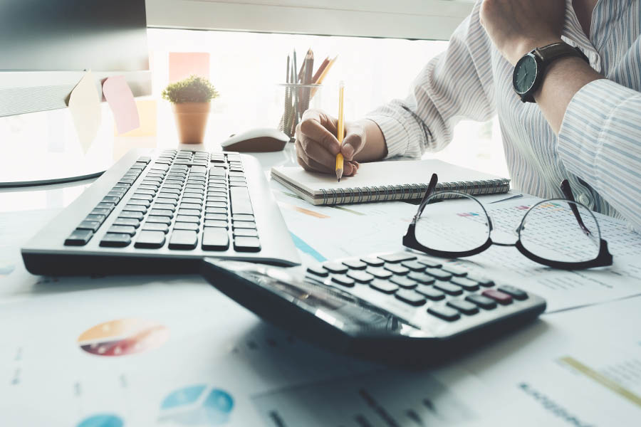 Bookkeeping Services - Accountant Looking Over the Books for Accuracy