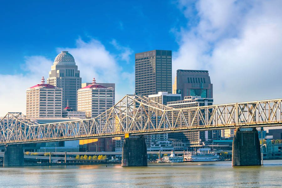 Louisville, KY Insurance - Louisville Skyline with the Bridge Leading into the City Looking Over the Water