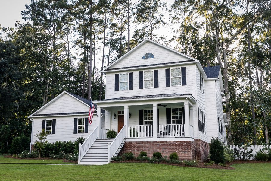 Personal Insurance - Modern Southern White Home with an American Flag in the Front of the Home