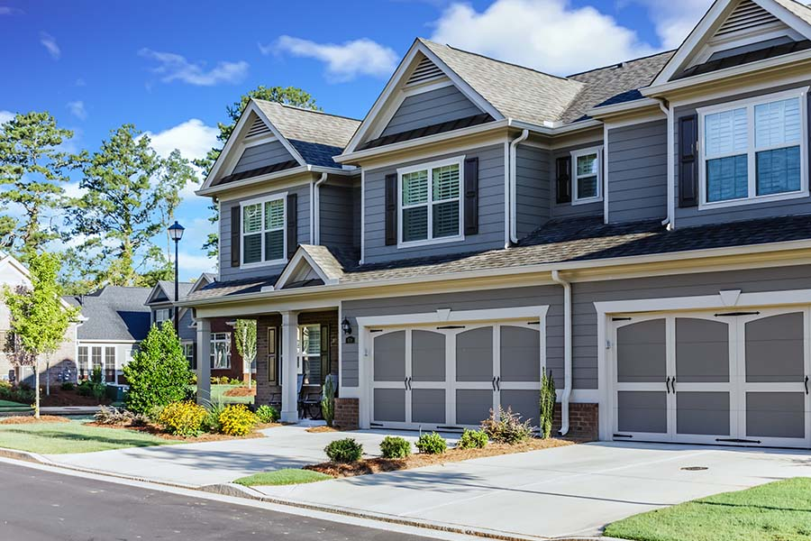 Blog - Residential Neighborhood With Nice Townhouses On Sunny Day