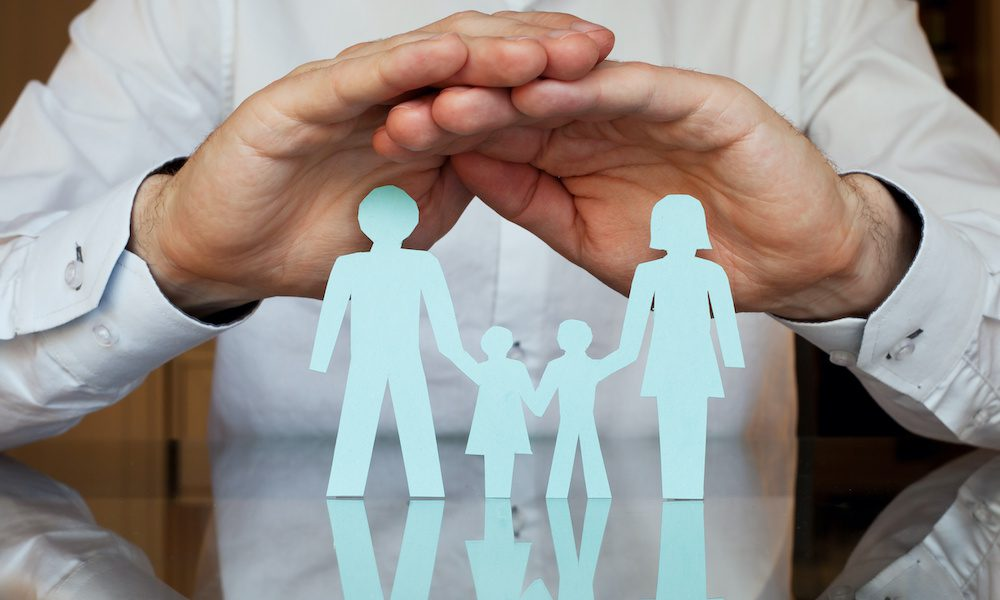Group Health Insurance Explained - Group Health Insurance Hands Over A Family